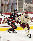 Adam Reid (NU - 8), Patrick Wey (BC - 6) - The Boston College Eagles defeated the visiting Northeastern University Huskies 3-0 after a banner-raising ceremony for BC's 2012 national championship on Saturday, October 20, 2012, at Kelley Rink in Conte Forum in Chestnut Hill, Massachusetts.