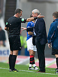 Referee Eddie Smith has words with Walter Smith