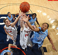 CHARLOTTESVILLE, VA- JANUARY 5: Chay Shegog #20 of the North Carolina Tar Heels grabs a rebound next to Lexie Gerson #14 and Chelsea Shine #50 of the Virginia Cavaliers during the game on January 5, 2012 at the John Paul Jones arena in Charlottesville, Virginia. North Carolina defeated Virginia 78-73. (Photo by Andrew Shurtleff/Getty Images) *** Local Caption *** Chelsea Shine;Lexie Gerson;Chay Shegog