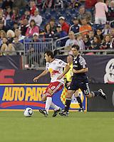 New York Red Bulls midfielder Sinisa Ubiparipovic (8) dribbles as New England Revolution forward Zack Schilawski (15) closes. The New England Revolution defeated the New York Red Bulls, 3-2, at Gillette Stadium on May 29, 2010.