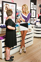 Erin Heatherton interview sales staff during the &quot;Incredible by Victoria's Secret&quot; launch at the Victoria Secret SOHO Store, August 10, 2010.
