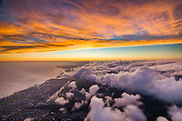 During a brilliant sunset, clouds roll over Honolulu, O'ahu.