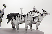 Origami zebras and ostriches designed by John Montroll.