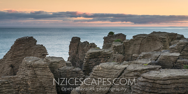 Dawn on coast in Punakaiki with weathered limestone formations, Paparoa National Park, West Coast, New Zealand