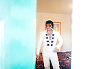 Steven Gillis, an Elvis tribute artist, gets into character in his room at the Masters Inn in Tampa February 14, 2010. Gillis is competing in the Elvis Extravaganza Nationals contest at the Florida State Fair.