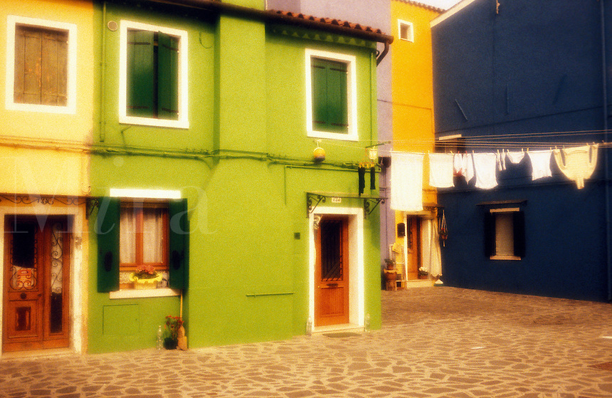 Italy, Island of Burano. Colorful homes with laundry hanging. One of the islands near Venice<br />