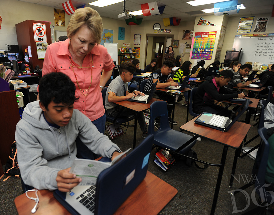NWA Democrat-Gazette/ANDY SHUPE<br /> Instructor Jeanie Nance (top) helps Abraham Koniske, 15, a sophomore at Har-Ber High School, with an English lesson Thursday, April 13, 2017, in the language academy meant for English language learners at the school in Springdale. A new law, Act 991, changes testing and performance requirements for English language learners in the state's academic accountability system.