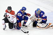 Gabriel Bourque (Canada - 7), Ivan Jankovic (Slovakia - 29), Tomas Halasz (Slovakia - 2) - Team Canada defeated Team Slovakia 8-2 on Tuesday, December 29, 2009, at the Credit Union Centre in Saskatoon, Saskatchewan, during the 2010 World Juniors tournament.