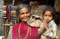 "Before leaving the village of Tanchok in the Middle Hills of Nepal,  I noticed an old woman carrying a young girl. I walked towards them and pointed to my camera. Once again I was greeted with two more smiles and another ""namaste"" from a beautiful child."