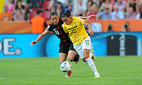 Alex Krieger (l) of team USA and Marta of team Brazil during the FIFA Women's World Cup at the FIFA Stadium in Dresden, Germany on July 10th, 2011.