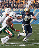 Pitt linebacker Matt Galambos (47) pursues a Miami ball carrier. The Miami Hurricanes football team defeated the Pitt Panthers 29-24 on  Friday, November 27, 2015 at Heinz Field, Pittsburgh, Pennsylvania.