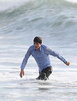 "February 4th, 2009 Venice Beach, California. Orlando Bloom on the set of ""The Good Doctor"". Orlando brought his dogs to the set and spent time with them during filming breaks. Orlando's scenes included him running at full speed from the beach into the ocean and then being overtaken by the waves. Bloom seemed very tired by the end of the day from all the running and ocean work. Photo by Eric Ford/ On Location News 818-613-3955 info@onlocationnews.com"