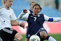 USA's Shannon Boxx fights for the ball with Germany's Alexandra Popp during their Algarve Women's Cup soccer match at Algarve stadium in Faro, March 13, 2013.  .