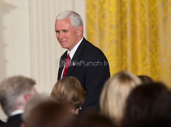 United States Vice President Mike Pence arrives at a joint news conference with U.S. President Donald J. Trump and President Juan Manuel Santos of Colombia at the White House in Washington, DC, May 18, 2017. <br /> Credit: Chris Kleponis / CNP /MediaPunch