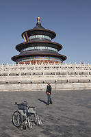 A visitor at the Temple of Heaven (Tian Tan), Beijing, China.