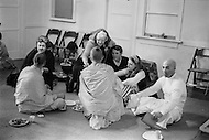 Hollywood, Los Angeles, CA - March 9, 1969<br /> Members of the religious organization, The International Society for Krishna Consciousness, inside of their new local  Krishna temple. They meditate, eat on the floor and play with their children.<br /> Hollywood, Los Angeles, Californie. 9 mars 1969.<br /> Les membres de la secte religieuse des Krishna, dans leur nouveau temple de Hollywood. Ils y &eacute;coutent de la musique, soignent leurs enfants ou mangent &agrave; m&ecirc;me le sol.