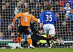 Scott Robertson scores Dundee Utd's third goal past the despairing hands of Allan McGregor
