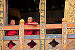 Asia, Bhutan, Punakha. Monks at Punakha Dzong.