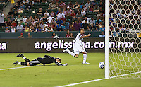 CARSON, CA – August 27, 2011: Chivas USA goalie Dan Kennedy (1) misses blocking the shot on goal by Real Salt Lake forward Alvaro Saborio (15) during the match between Chivas USA and Real Salt Lake at the Home Depot Center in Carson, California. Final score Chivas USA 0, Real Salt Lake 1.