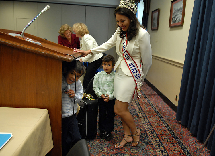Mrs. United States 2004 Edrienne Carpenter, tries to corral her children Logan, 5, left, and Austin, 4, before she spoke at a news briefing about her personal experience with postpartum depression and the importance of screening and treating the potentially life-threatening disease.