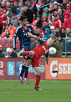 21 April 2012: Chicago Fire forward Orr Barouch #15 and Toronto FC defender Richard Eckersley #27 in action during the second half in a game between the Chicago Fire and Toronto FC at BMO Field in Toronto..The Chicago Fire won 3-2...