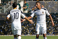 LA Galaxy midfielder Landon Donovan gives a low five to teammate Sean Franklin. The Chicago Fire beat the LA Galaxy 3-2 at Home Depot Center stadium in Carson, California on Sunday August 1, 2010.