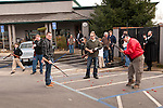Shells litter the pavement from the shotgun-toting locals gather at Mel's Drive-in restaurant to fire off rounds during Jackson, California's Serbian community celebrates Christmas on the Julian Calendar date of January 7.