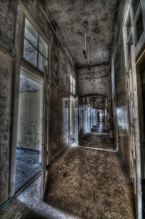 Abandoned lunatic asylum north of Berlin, Germany. Empty corridor with open doors.