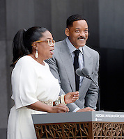 Oprah Winfrey and Will Smith speak at the opening ceremony of the Smithsonian National Museum of African American History and Culture on September 24, 2016 in Washington, DC. The museum is opening thirteen years after Congress and President George W. Bush authorized its construction. <br /> Credit: Olivier Douliery / Pool via CNP / MediaPunch