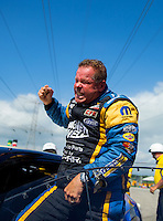 Jul 12, 2015; Joliet, IL, USA; NHRA pro stock driver Allen Johnson celebrates after winning the Route 66 Nationals at Route 66 Raceway. Mandatory Credit: Mark J. Rebilas-USA TODAY Sports