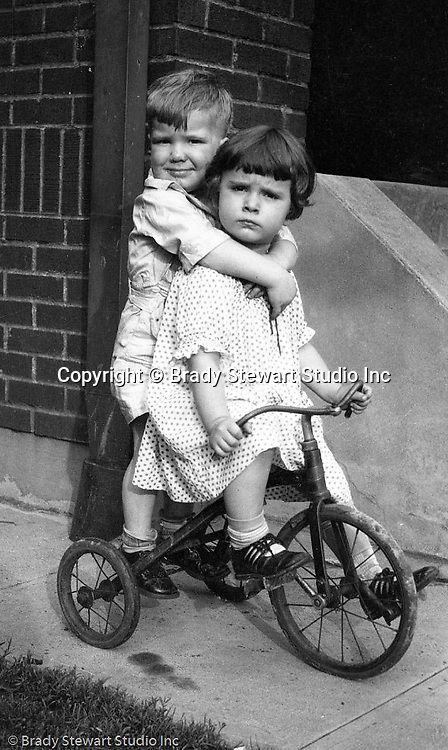 Wilkinsburg PA:  Helen Stewart neighbors riding their tricycle on the side walk - 1919.
