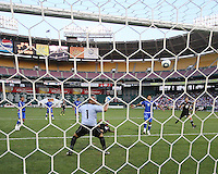 Julius James #2 of D.C. United shoots the ball over the goal of Dagoberto Portillo #1 of El Salvador during an international charity match at RFK Stadium, on June 19 2010 in Washington DC. D.C. United won 1-0.
