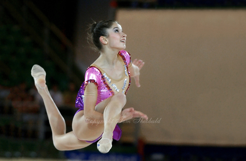 October 18, 2001; Madrid, Spain:  SIMONA PEYCHEVA of Bulgaria leaps with clubs at 2001 World Championships at Madrid.