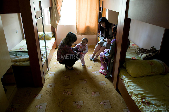 SULAIMANIA, IRAQ: Rezan meets with a client and her baby at a women's shelter in Sulaiymaniya.  The shelter is an emergency shelter run by the Directorate for Following up Violence Against Women.  She is threatened with honor killing by her family for having sex outside of marriage..