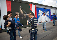 Tourists at the East Side Gallery, site of the former Berlin Wall that separated East Germany from West Germany. November 2009 marks the 20th anniversary of the fall of the Berlin Wall.
