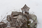 MARCH 13, 2011 - NEW PALTZ: Rustic wood gazebo on boulders, seen from above, on frozen Lake Mohonk in Mohonk Mountain House area, in winter, in upstate New York, New Paltz, New York. (Editorial Use Only)