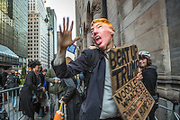 NEW YORK,NY APRIL 14: One of the assistant to the Anti Trump protest in midtown Manhattan wears a Trump face mask in Manhattan on April 14,2016 in New York City. Photo by VIEWpress/Maite H. Mateo