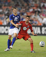 DC United defender Perry Kitchen (23) shields the ball  against Everton midfielder Diniyar Bilyaletdinov (7)    Everton defeated DC United 3-1 in a international friendly ,at RFK Stadium, Saturday July 23, 2011.