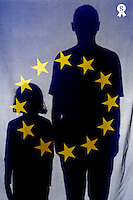 Silhouette of girl (6-7) and man behind European Union Flag (Licence this image exclusively with Getty: http://www.gettyimages.com/detail/sb10068346w-001 )