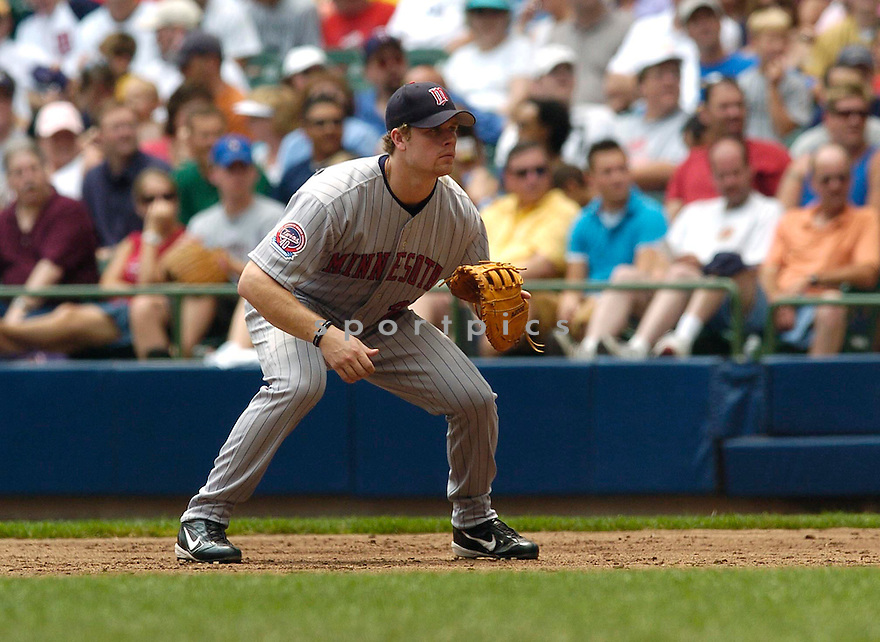 Justin Morneau of the Minnesota Twins in action against the Milwaukee Brewers. ....Twins won 5-2.....Chris Bernacchi  / SportPics..
