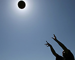 Joel Vega, 15, of Cathedral City eclipses the sun with a basketball as he practices at Panorama Park in Cathedral City on Tuesday, June 19, 2007. Vega says he is a small forward for the Cathedral City High School junior varsity basketball team. The temperature on Tuesday was 109 degrees.