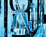 Glass vials and beakers used in medical scientific research lab.