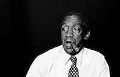 Denver Colorado<br /> USA<br /> June 10, 1983<br /> <br /> Comedian Bill Cosby backstage after a performances at McNichols Sports Arena.  <br /> <br /> William Henry &quot;Bill&quot; Cosby, Jr. (born July 12, 1937) is an American comedian, actor, author, television producer, educator, musician and activist. A veteran stand-up performer, he got his start at various clubs, then landed a starring role in the 1960s action show, I Spy. He later starred in his own series, the situation comedy The Bill Cosby Show, in 1969. He was one of the major characters on the children's television series The Electric Company for its first two seasons, and created the educational cartoon comedy series Fat Albert and the Cosby Kids, about a group of young friends growing up in the city. Cosby has also acted in a number of films.<br /> <br /> During the 1980s, Cosby produced and starred in what is considered to be one of the decade's defining sitcoms, The Cosby Show, which aired eight seasons from 1984 to 1992. The sitcom highlighted the experiences and growth of an upper-middle-class African-American family. He also produced the spin-off sitcom A Different World, which became second to The Cosby Show in ratings. He starred in the sitcom Cosby from 1996 to 2000 and hosted Kids Say the Darndest Things for two seasons.<br /> <br /> He has been a sought-after spokesman, and has endorsed a number of products, including Jell-O, Kodak film, Ford, Texas Instruments, and Coca-Cola, including New Coke. In 2002, scholar Molefi Kete Asante included him in his book, the 100 Greatest African Americans.
