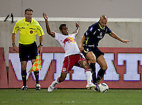 Kyle Naughton (16) of Tottenham fights for the ball with Roy Miller (7) of the New York Red Bulls during the Barclays New York Challenge at Red Bull Arena in Harrison, NY.  Tottenham defeated the New York Red Bulls, 2-1.