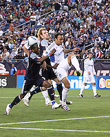 New England Revolution forward Sainey Nyassi (14), New England Revolution midfielder Pat Phelan (28) and San Jose Earthquakes defender Ramiro Corrales (12) compete for a cross ball near the Earthquakes goal.  The New England Revolution and San Jose Earthquakes play to a scoreless draw at Gillette Stadium on May 15, 2010