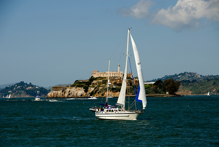 California, San Francisco: Alcatraz Island and sailboat observed up close from Pier 39..Photo #: 14-casanf78199.Photo © Lee Foster 2008