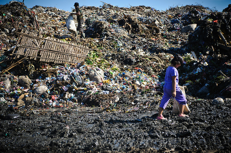 Erni, 10, walking to work at the 'Trash mountain', Makassar, Sulawesi, Indonesia.