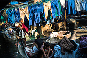 Washermen (locally known as Dhobis) wash hospital clothes at the Laundromat in Dhobighat in India's financial capital, Mumbai, India. The laundry comes from different sections of the society - from hospital to hospitality to garment factories and normal households.