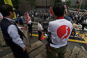 June 5, 2011- Right wing counter demonstrators shout 'Get out of Japan' and give the finger gesture to Left wing Anti-Nuclear demonstrators just up the road from TEPCO's Shinbashi Office in Tokyo, Japan. Around 200 left-wing protesters marched in front of TEPCO's office in Shinbashi chanting 'No Nukes, No more Hiroshima, No more Nagasaki and no more lies'. The group of about 20 right wing counter demonstrators and seven sound vans were blocked from reaching the left wing by Tokyo Police. (Photo by B.Meyer-Kenny/2.0 Images)