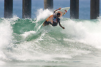 Brazilian Wiggolly Dantas turns off the top during round of 96 of the 2010 US Open of Surfing in Huntington Beach, California on August 4, 2010.